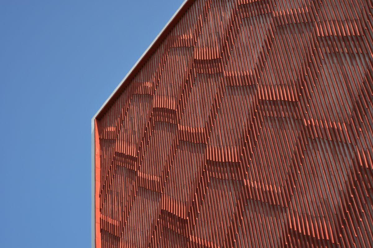 Clay roof tiles façade to minimize heat gain and has decorative function, at Vadodara, by Manoj Patel Design Studio 6
