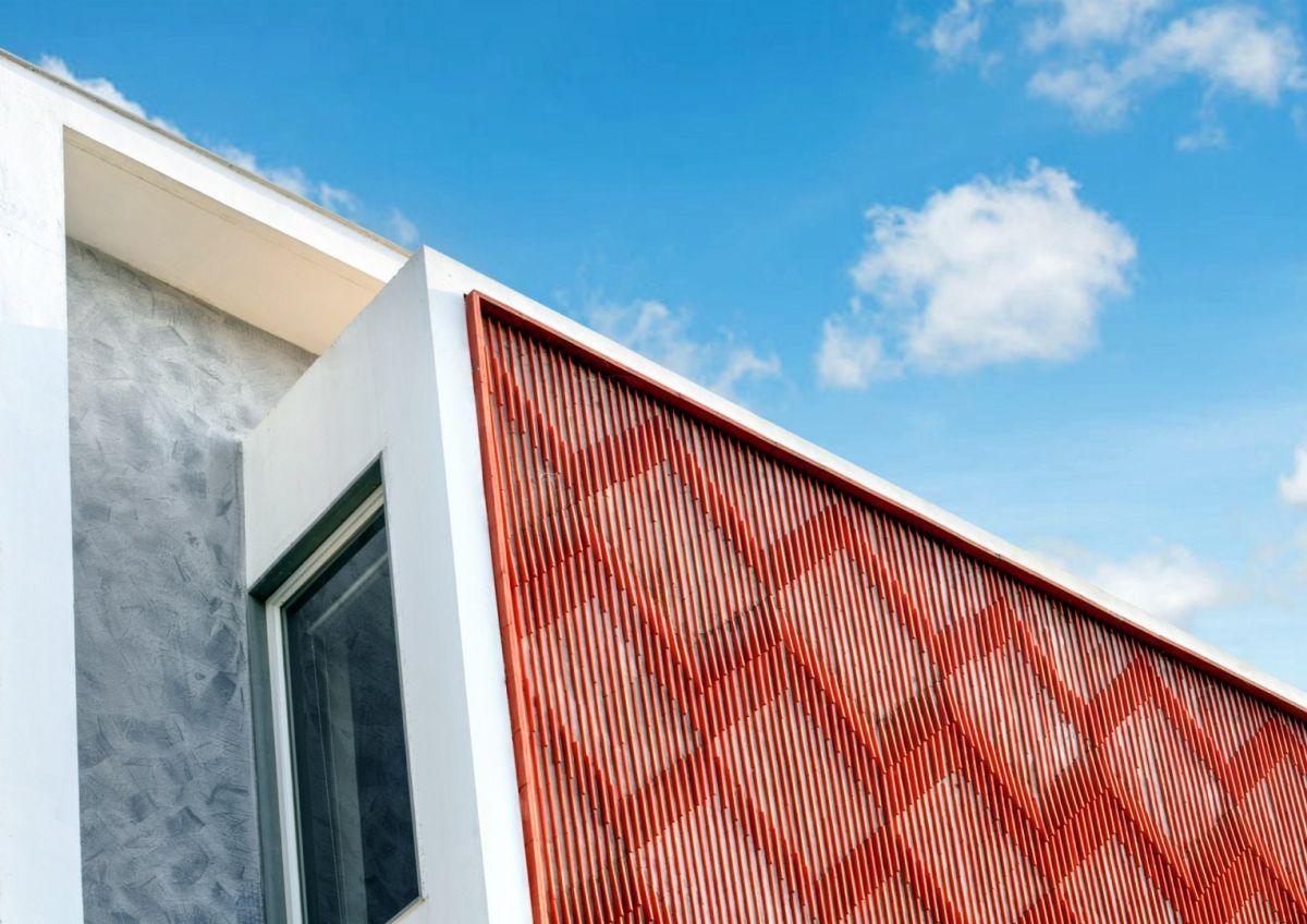 Clay roof tiles façade to minimize heat gain and has decorative function, at Vadodara, by Manoj Patel Design Studio 87