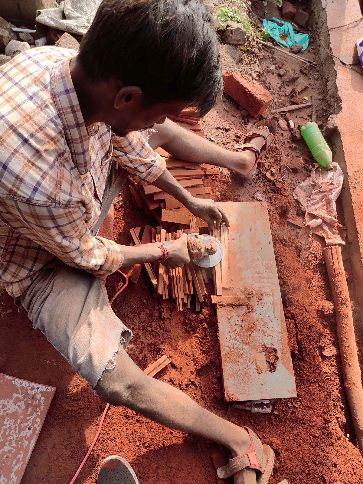 Clay roof tiles façade to minimize heat gain and has decorative function, at Vadodara, by Manoj Patel Design Studio 81