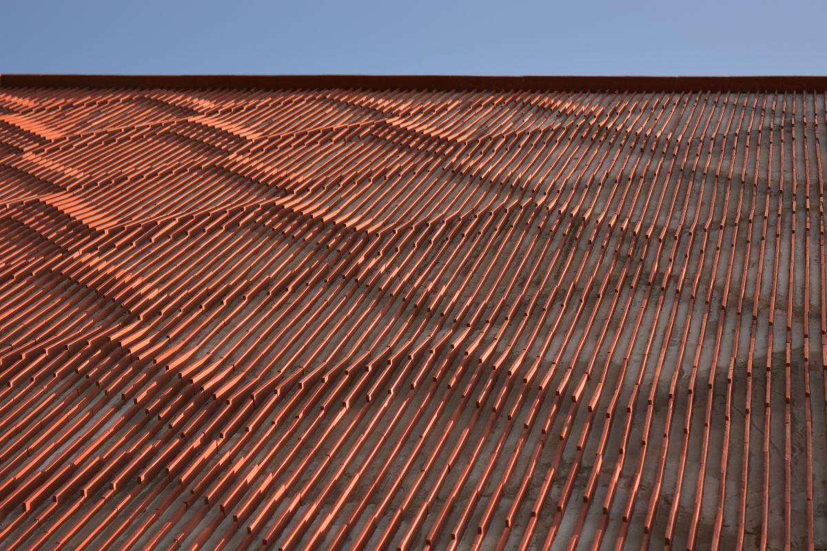 Clay roof tiles façade to minimize heat gain and has decorative function, at Vadodara, by Manoj Patel Design Studio 92