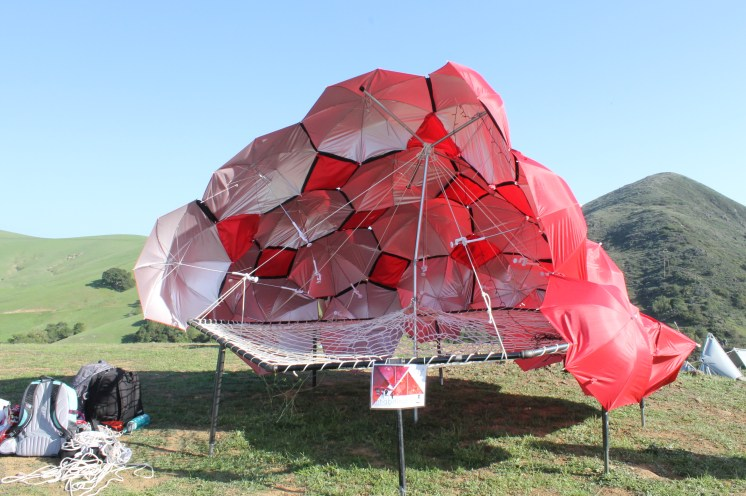 A structure composed of mostly umbrellas.