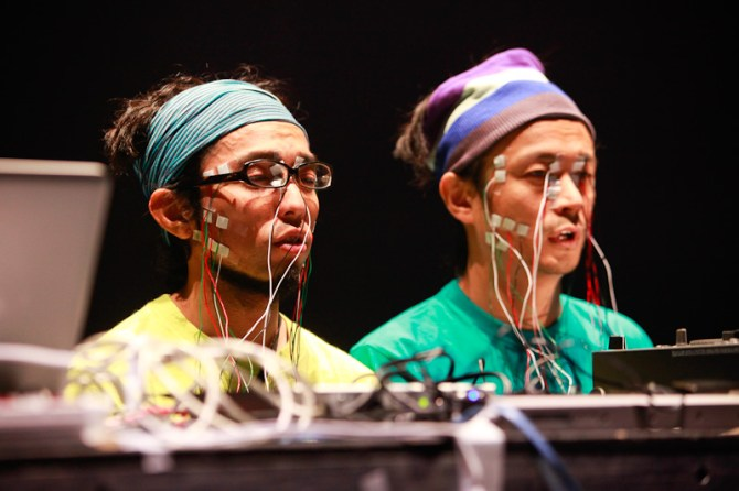 Daito Manabe performed with electrodes attached to their face which spasmed in time with the music