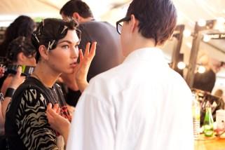 Model Tallulah Morton getting made up backstage for Seventh Wonderland