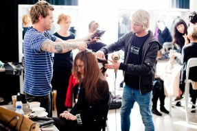 The models go through hair and makeup
