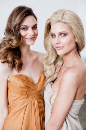 Models Kathryn Lyons and Sophie Van Den Akker in her wig
