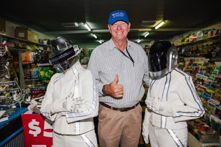 Conrad, the Mayor of Wee Waa with a couple of Daft Punk fans in the local newsagent