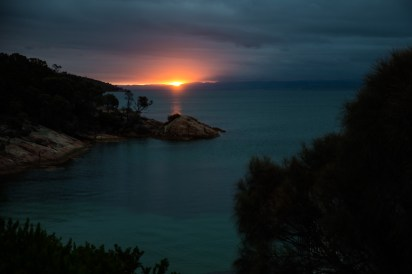 The sun sets at Honeymoon Bay in Freycinet National Park