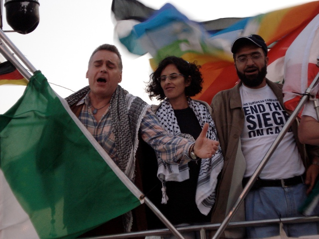 Italian Opera Singer Joe Fallisi, Free Gaza organizer Lubna Masrawa, and Palestinian activist Ghazi Abourashed, singing as they arrive in Gaza (October 2008)