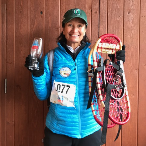 Judy Holmes with Maine Guide Snowshoes after 1st place win, Beaver Creek Running Series 2018