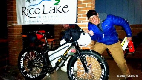 Charly Tri with the hospitable and friendly Rice Lake, WI, welcome sign for all the Tuscobia Winter Ultra competitors