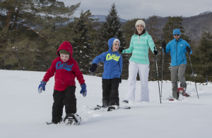 A family of snowshoers on the trail.
