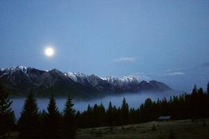 A stunning moonrise over the Canadian Rockies.