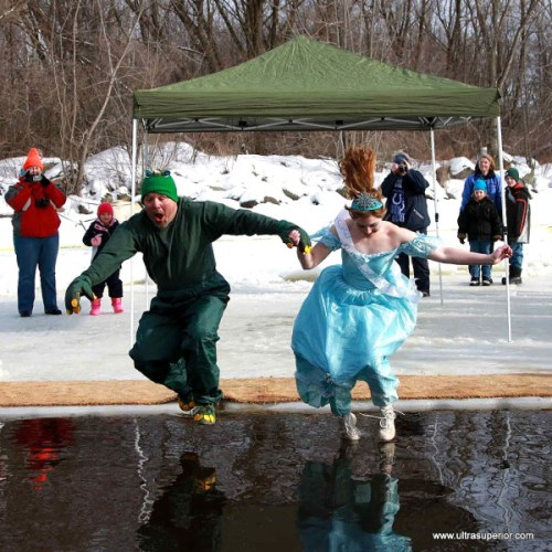 Annual tradition at Udder Snowshoe Race, Athens, WI: Queen dives in, sometimes with a helping hand.