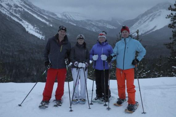 Snowshoers posing on snowshoe tour at Castle Mountain Resort, Alberta
