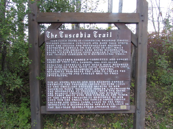 Sign commemorating Hulda Hilfiker's efforts to create the Tuscobia Trail circa 1968