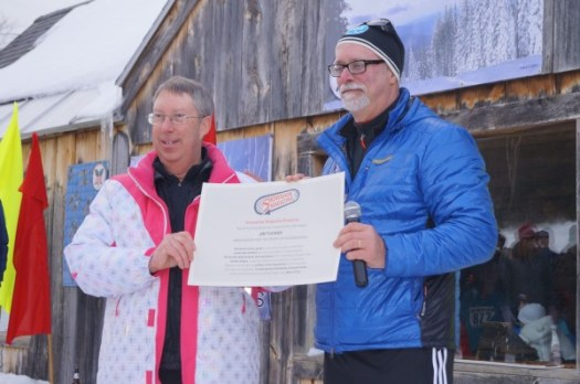 Jim Tucker (L), Athletic Director of Paul Smith's College, receives the honor of the 2014 Cindy Brochman Snowshoe Person of the Year from USSSA Sports Director, Mark Elmore