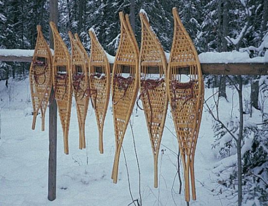 traditional snowshoers hanging on a fencepost