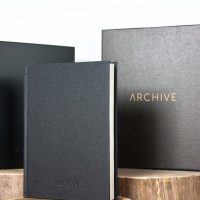 Black archival buckram book cloth finish journal with wooden storage box and packaging