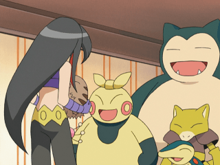 Pike Queen Lucy, with long black hair with red highlights, holding a pig-like Swinub, with a sumo-styled Makuhita, shrew-like Cyndaquil, humanoid Abra, bear-like Snorlax, and mostly-hidden Skitty around her. These Pokémon are all happy to see her.