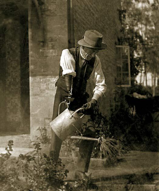 Frank Chapman watering his garden