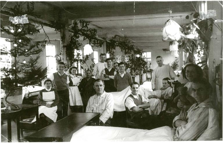 The FEPOW ward at Christmas with Sister Mary 'Scarlet' O'Hara seated front left