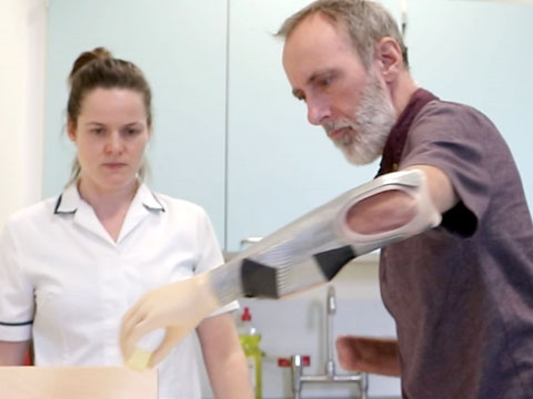 Mike Davies tries a myoelectric arm