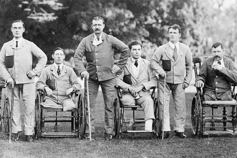 A group of soldier amputees in the garden at Roehampton