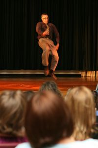 Torrington High School art teacher Victor Leger, the district's 2010-11 teacher of the year, performed an Appalachian clog dance during the district's convocation Wednesday, after urging fellow teachers to never pass up a chance to demonstrate a skill. Jim Moore / Republican-American