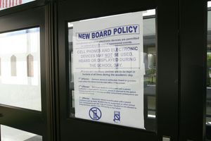 A sign on the front door of Torrington High School warning detailing the district's new policy banning electronic devices greeted students arriving for the first day of classes Tuesday. Administrators said most students complied, though an iPod and a small number of phones were confiscated. Jim Moore Republican-American.