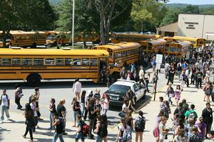 Torrington High School students board buses at the conclusion of their first day of classes Tuesday. Jim Moore Republican-American.