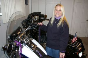 Dina Viel and her 2010 Harley-Davidson Softail Deluxe, which she has stored for the winter in her home office at her Torrington home. Bud Wilkinson / Republican-American