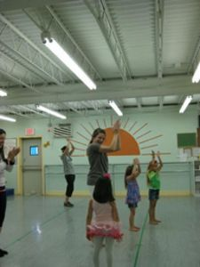 Jacqueline Crowe demonstrates a dance to children who attended a fundraiser for Best Foot Forward during last year's National Dance Day on July 31, 2010.
