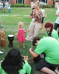 Lily Birch Sirignano, age 2, reacts to the impromptu drumming around her as Litchfield Jazz Camp students pick up a beat on a variety of drums on display at the African Heritage Collection booth from Bristol Friday evening at the Litchfield Jazz Festival. Her mother, Lindsay Birch, stands behind her and is a volunteer at the fesival and her father is the festival stage manager. Lynn Mellis Worthington Republican-American