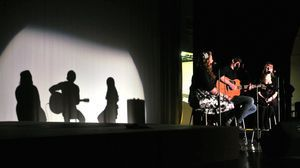 Sisters Brittany and Jennifer Casaburi sing with 2010 American Idol contestant Tim Urban during a benefit concert Sunday at Torrington High School. The concert was a fundraiser for the sophomore class at Torrington High School. Jim Shannon/RA