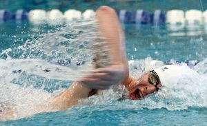 Winsted, CT-030312MK24 2012 Litchfield's Nick Rinaldi completes the anchor leg of the 200 yard freestyle relay to help his team win with a time of 1:37:07 during the annual Berkshire League Swimming & Diving Championships Saturday afternoon at the Hotchkiss School pool in Lakeville. Litchfield took home the over all title. Michael Kabelka / Republican-American