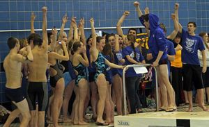 Winsted, CT-030312MK20 2012 The Litchfield swimteam celebrate their vicotry in the Annual Berkshire League Swimming & Diving Championships Saturday afternoon at the Hotchkiss School pool in Lakeville.. Michael Kabelka / Republican-American