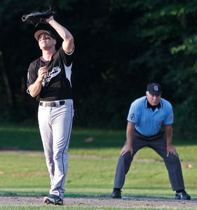 WATERBURY, CT- 10JULY072412MK10 Waterbury Wild's Bead Devito pulls in a pop fly at first base during their opening round against Fedell in the Stan Musial state tournament Tuesday evening at Waterville park in Waterbury. Michael Kabelka / Republican-American