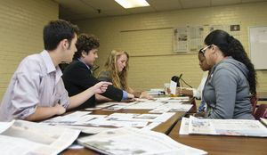 Republican-American Journalism Academy participants practice designing a newspaper page. From left to right, Jack McKernan, Jonathan Esty, Alexandra Pape, Knychelle Passmore, and Celeste Crespo.  Erin Covey Republican-American.
