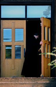 Father John Hopko, Pastor of Saints Cyril & Methodius Orthodox Church in Terryville walks through the church's front doors last week. Alec Johnson/ Republican-American