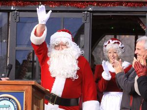 Santa acknowledges the cheers of the crowd gathered outside Christmas Village in Torrington on Sunday. John McKenna/RA