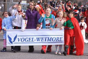 Students from the Vogel-Wetmore School march in the parade leading to Torrington's Christmas Village on Sunday. John McKenna/RA