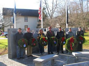 A number of local veterans participated in the annual Wreaths Across America ceremony Saturday, led by Jennie Mae Rehnberg at the Veteran's Memorial. From left, Joseph MacRitchie, George Crenna, Lori Zidak, Marc Bornn, Andrew Ocif, Jack Osborne and Thomas Page. CONTRIBUTED