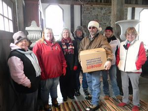 Volunteers of the Sunday in the Country Food Drive dispensed food for the holidays to many food pantries and individuals Saturday at its annual Christmas giving. Those who were running the activity, which is organized by 'NASCAR' Dave MacMillan, are, from left: Janice Fenn, Nancy Cookingham, Colleen McGhee, Bill Anstett, Dave Peterson, Lisa Peterson and Christine MacMillan.  Ruth Epstein Republican-American