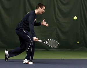 Luke Roser, a freshman on the Quinnipiac University men's tennis team, plays doubles during a fundraiser at the Middlebury Racquet Club on Sunday afternoon in Middlebury. The event raised money for the Sandy Hook Support Fund. Christopher Massa/RA