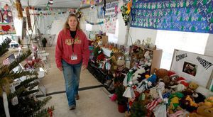 Chaplain Renee Gilbert is on hand to greet guests at gathering place just off I-84 at Exit 10 in Newtown Wednesday. The tent that sprang up just after the Sandy Hook Elementary School shooting has become a place for people to mourn the victims. Steven Valenti Republican-American