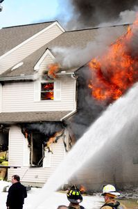 A house at 64 Griswold St. in Torrington burns Monday afternoon. Alec Johnson/RA