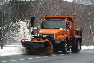 A plow truck clears off the edge of road on Greenwoods Road East (Route 44) near Norfolk following a snowstorm on Friday.  Jim Shannon Republican-American