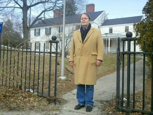 Buckingham Street resident William Moran stands in front of the white house that had once been an administration building for the University of Connecticut, but is now vacant and has fallen into disrepair. Moran said the blighted house is an eyesore in the historic Hillside neighborhood. Mike Patrick/RA