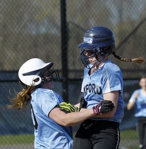 Oxford, CT- 25 April 2013-042513CM07- Oxford's Meg Sastrum, right, is congratulated by teammate Ally Sweeney after belting an inside-the-park home-run against Notre Dame during SWC softball action Thursday afternoon in Oxford. Christopher Massa Republican-American