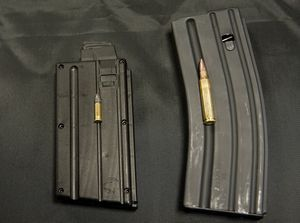 Mark Malkowski, owner of Stag Arms in New Britain, talks about his company's newly designed Stag-22. The firearm will use a .22 caliber bullet, left, compared to the .223 (right), that was used in the AR-15.  Jim Shannon Republican-American